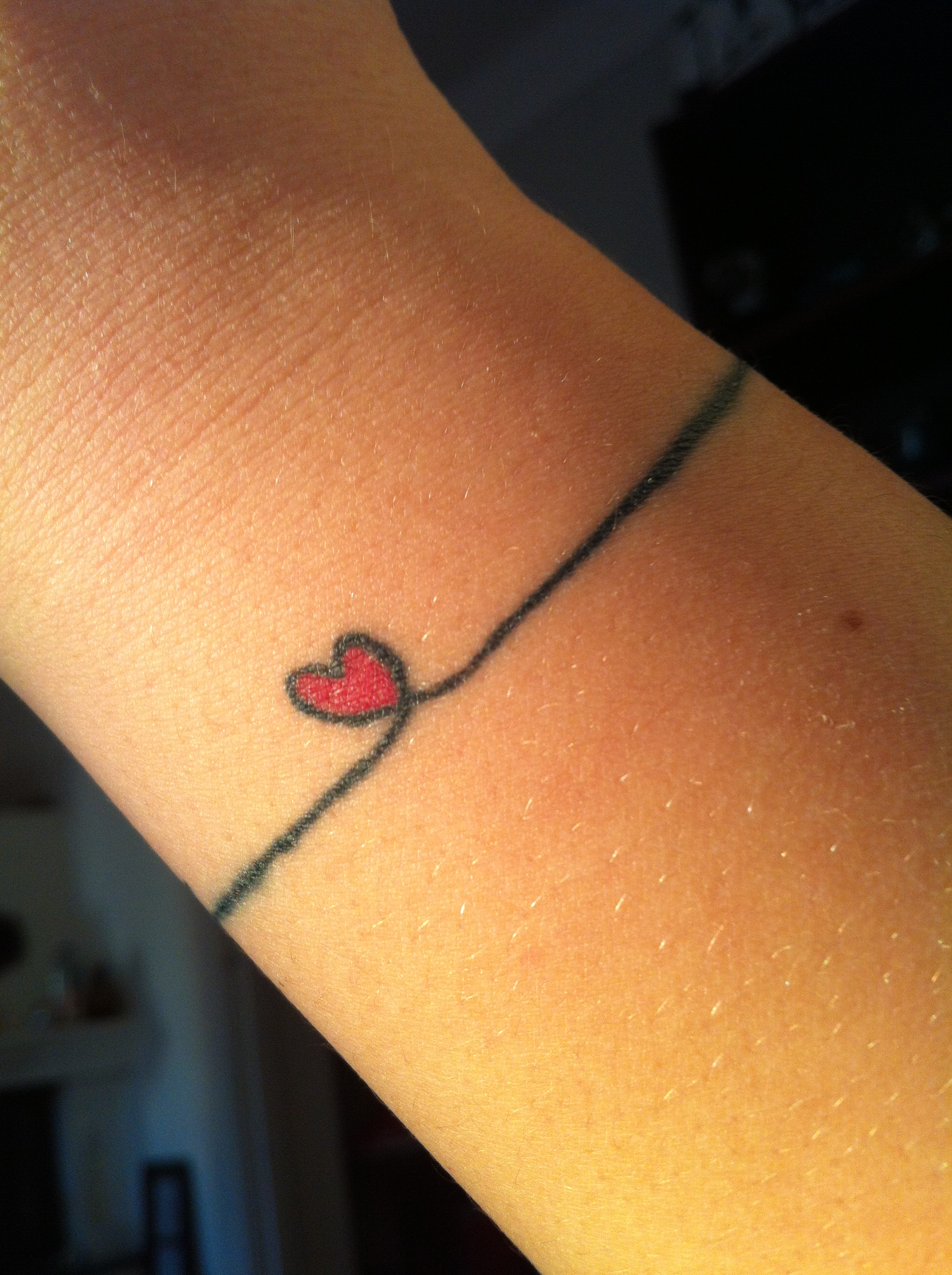 Little heart tattoo on wrist - 14small Heart Color And Thin Band Around Wrist