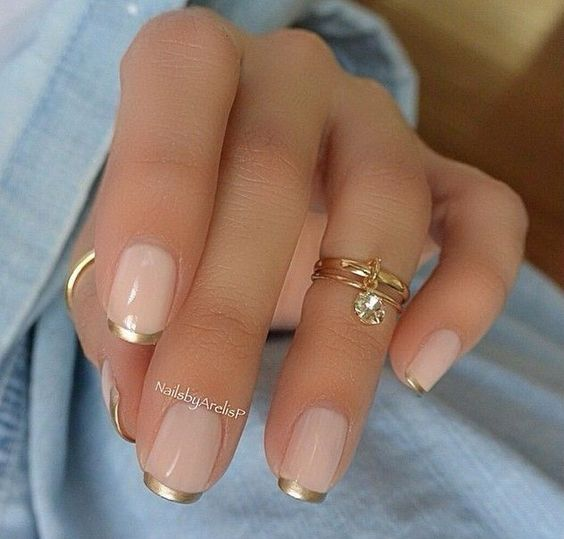 Gold nails 35 gold nail designs we are starting off our list with a classic minimalist nail art with nude base polish and thin golden french tips instead of the regular white tips prinsesfo Image collections