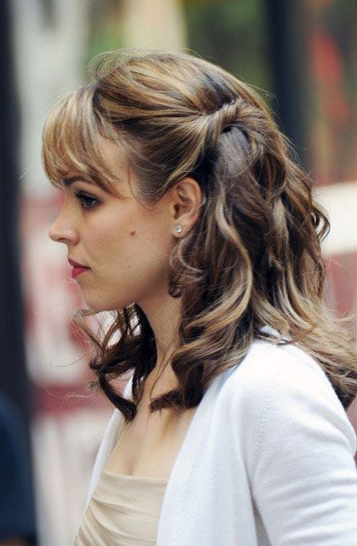 Voluminous low side ponytail with a twist