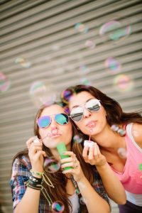 Best Friends Blowing Bubbles