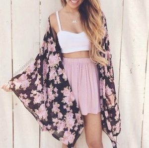 Floral kimono with white bralette and pale pink skirt.