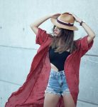 Red kimono with black shirt and jeaned shorts