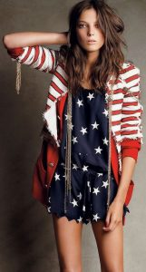 Navy romper with white stars and a red and white-striped cardigan.