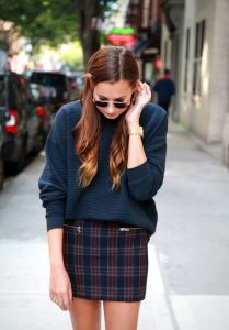 Navy sweater and plaid skirt