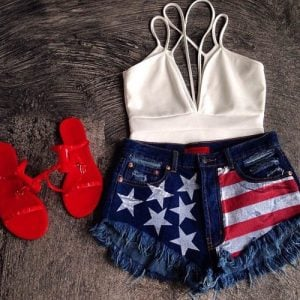American flag shorts with white top and red sandals