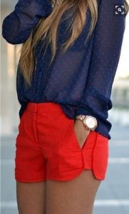 Red shorts and navy lightweight long-sleeved blouse