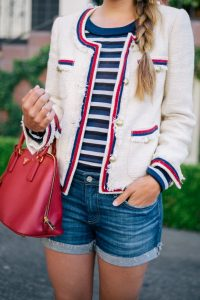 White jacket accented with red and navy with cuffed jean shorts