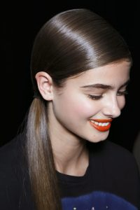 Low side ponytail with dramatic side bangs heart shape