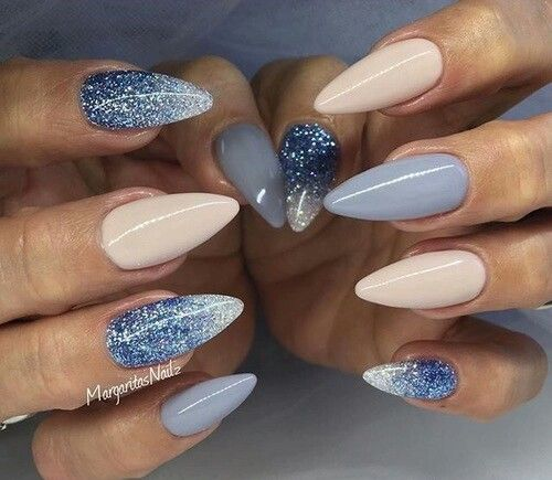 This Beautiful Acrylic Almond Nail Design Features Various Shades Of Blue From Matte Baby To Dark Royal Glitter Polish All Mixed With Nude And