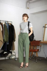 Green utility pants, white top and single strap sandals