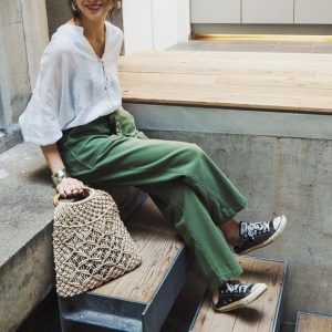 Loose green pants, White top and Sneakers