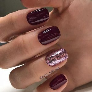 Pink Glittered Ring Finger Nail