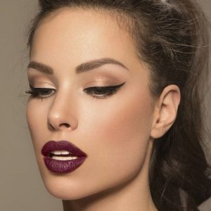 Plum Lipstick With Winged Eyeliner