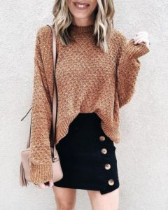 brown sweater and black mini skirt