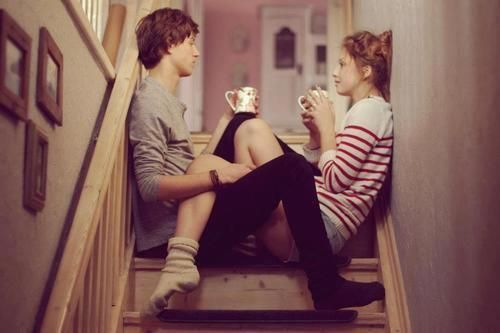 sitting on stairs drinking coffee