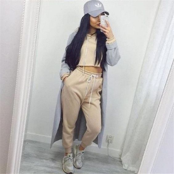 beige sweatsuit set and grey jacket