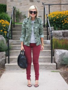camo jacket and burgundy jeans