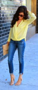 yellow blouse and jeans