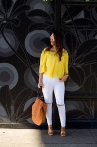 blouse and white jeans