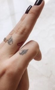 Angel Wings and Hand Tattoos