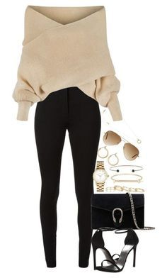 beige sweater black pants