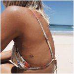 tiny sun tattoo