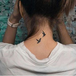 bird-back-of-neck-tattoo