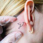 infinity-bird-behind-the-ear-tattoo