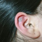 inside-ear-daisy-flower-tattoo