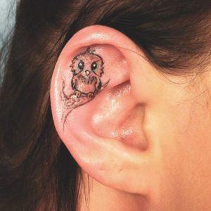 inside-ear-owl-tattoo