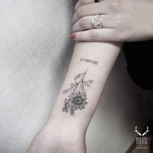 paired-daisy-flower-tattoo