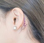 purple-flower-behind-the-ear-tattoo